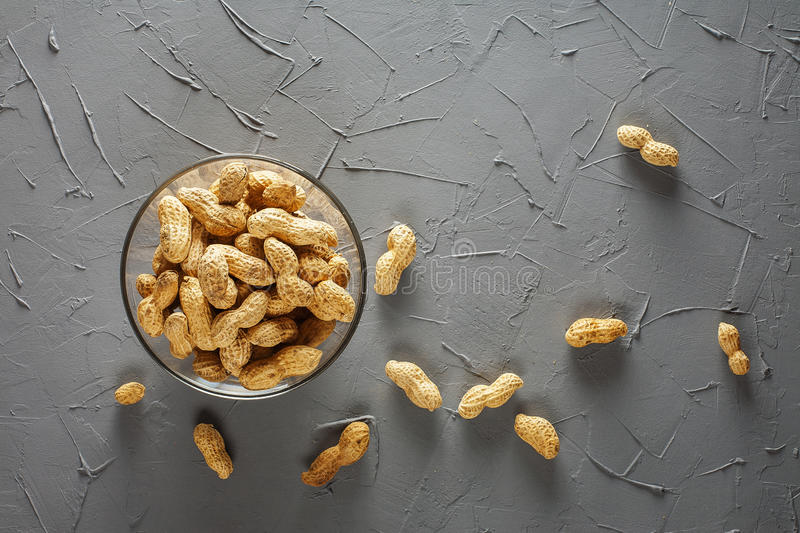 A pile of peanuts in the glass bowl royalty free stock photography