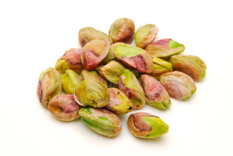 Pile of peeled pistachio nuts isolated stock photo