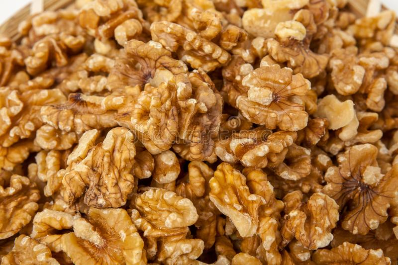 Pile of peeled walnuts stock images