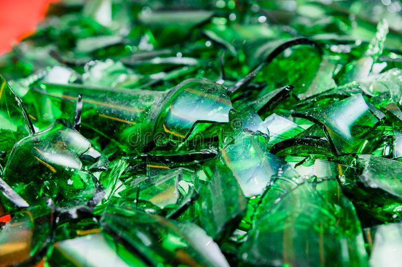 Pile of pieces of broken green bottle glass royalty free stock photo