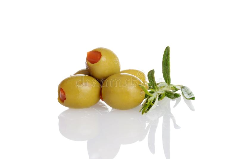 Pile of pimento green olives with fresh rosemary herb royalty free stock photos