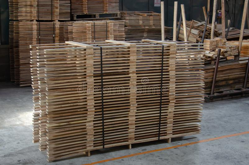 Wood pine. Pile pine processing plant.Stacked wood pine timber production for furniture production royalty free stock photo