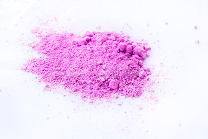 Pile of pink powder isolated on white background royalty free stock photos