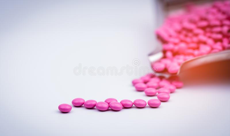 Pile of pink round sugar coated tablets pills on drug tray with copy space. Pills for treatment antianxiety, antidepressant and migraine headache prophylaxis stock photography