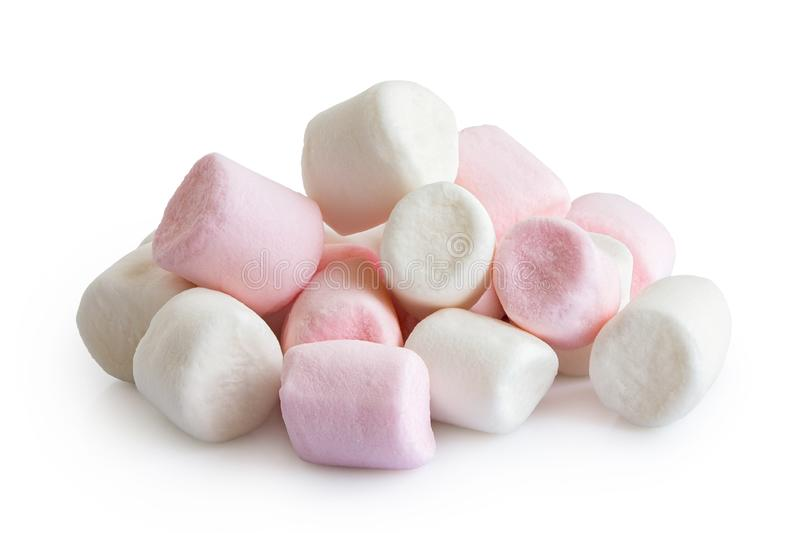 Pile of pink and white mini marshmallows isolated on white.  stock images
