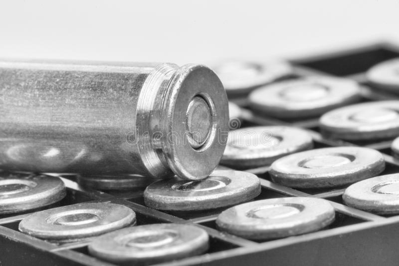 Pile of pistol bullets. The concept of limiting the spread of small arms. Black and white image. Close-up, background stock photography