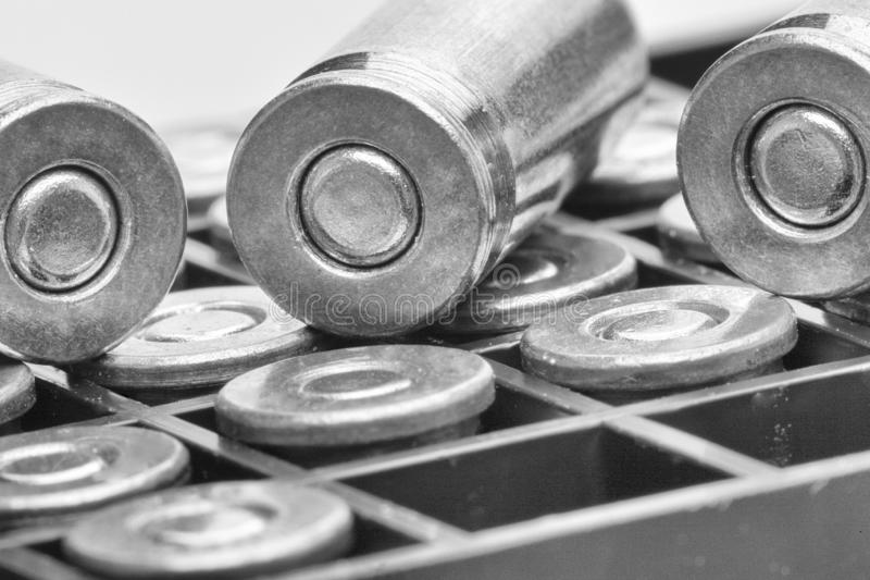 Pile of pistol bullets. The concept of limiting the spread of small arms. Black and white image. Close-up, background royalty free stock photography