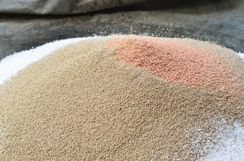 Pile of plant chemical fertilizer. On ground royalty free stock image