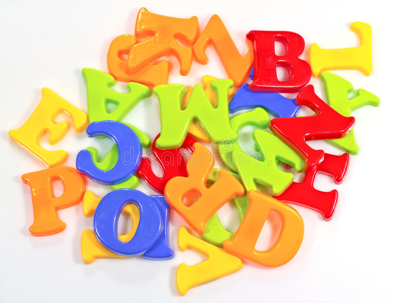 Pile of Plastic Alphabets stock photos