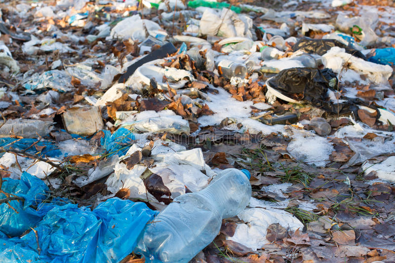 Pile of plastic bags and other refined petroleum products dumped in landfill. Garbage heap gives infiltrate into ground. Water. Waste sorting is required. Lviv royalty free stock photo