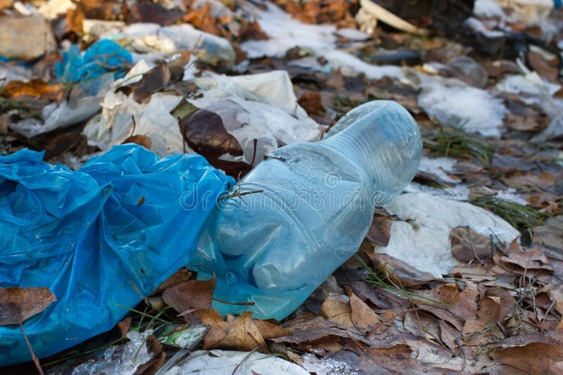 Pile of plastic bags and other refined petroleum products dumped in landfill. Garbage heap gives infiltrate into ground. Waste sor. Pile of plastic bags and royalty free stock photo