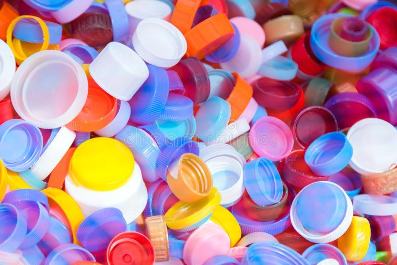 Pile of plastic bottle caps texture. A lot of bottle tops of soft drinks, plastic recycling royalty free stock photo