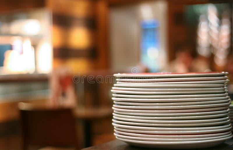 Pile of plates stock photos