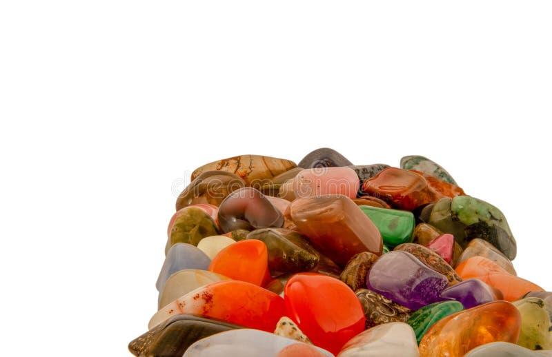 Pile of gemstones on white background. Polished gemstones. royalty free stock image