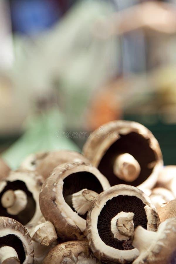 Pile of Portobello mushrooms at market stock photos