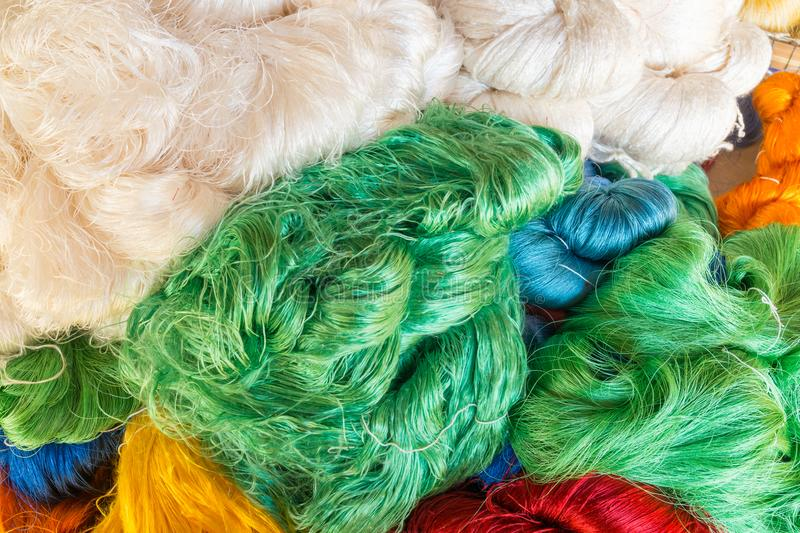 Pile of Process Multicolor Raw Silk Thread or Yarn as Pattern Ba stock image