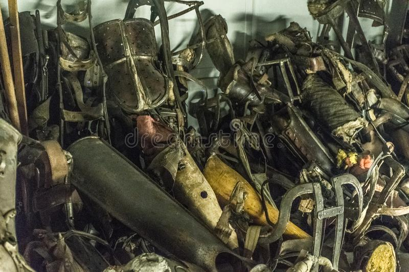 Oswiencim, Poland - September 21, 2019: Pile of prostheses in former German Nazi Concentration and Extermination Camp. Pile of prostheses in former German Nazi stock photography