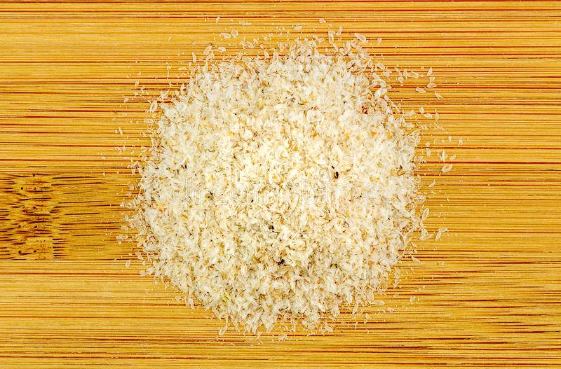 Pile of Psyllium on wooden background royalty free stock photography