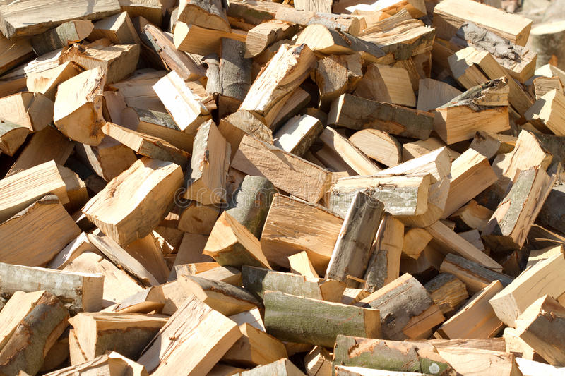 Pile of raw firewood royalty free stock images