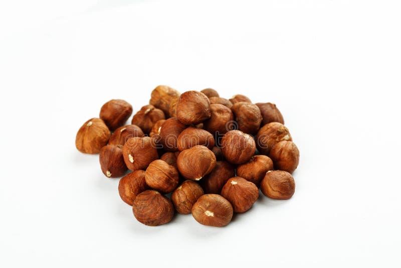 Pile of raw hazelnut on a white background.  stock photography