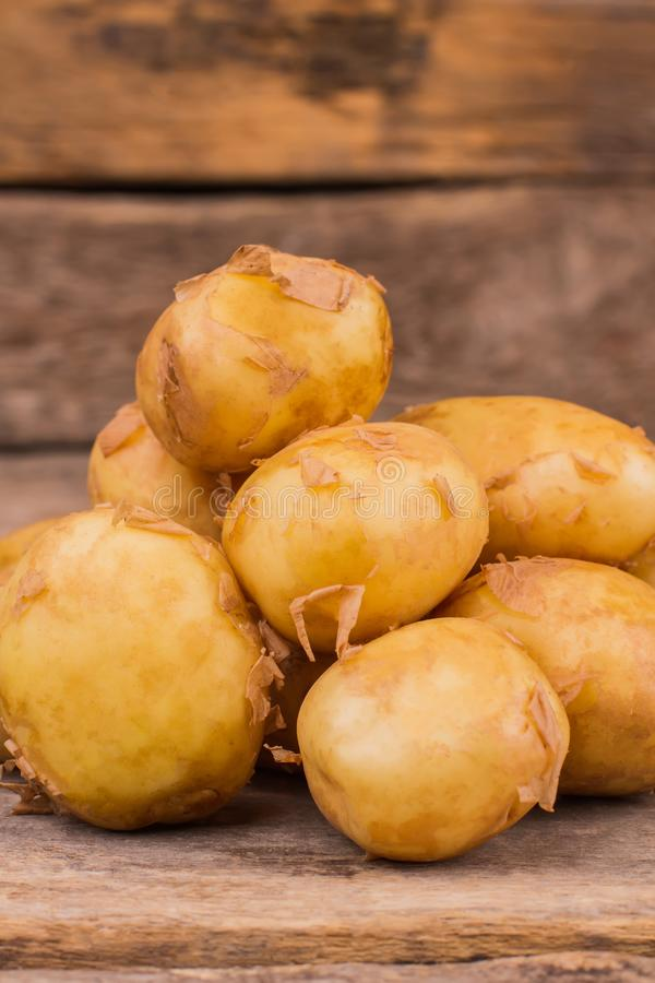 Pile of raw potatoes. Close up. Gather of potoatoes stock images