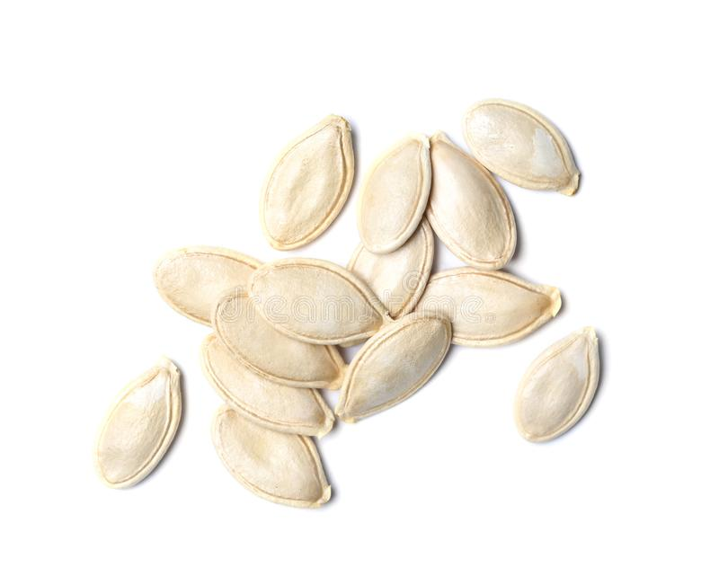 Pile of raw pumpkin seeds on white background stock photography