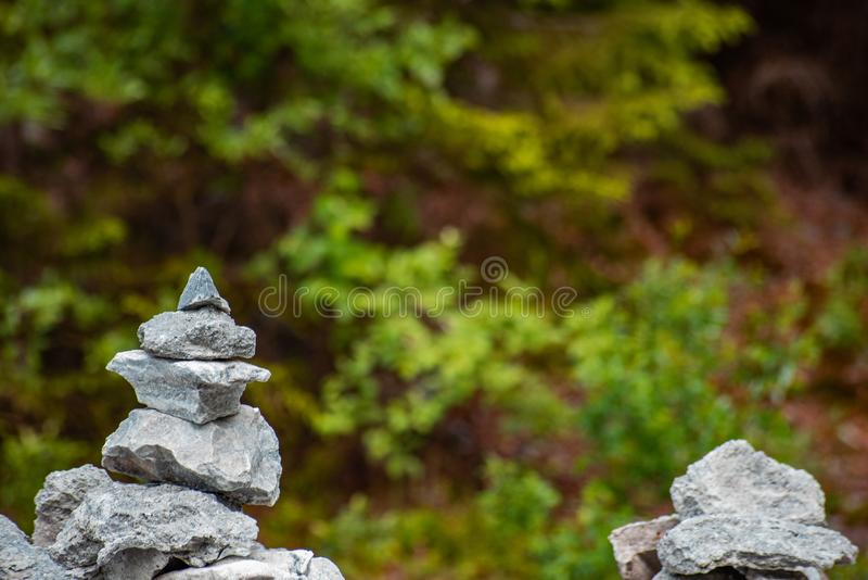 A pile of real pyramid shaped stoneson the background of greenery, soft focus. A pile of real pyramid shaped stones on the background of greenery is close, soft royalty free stock photography