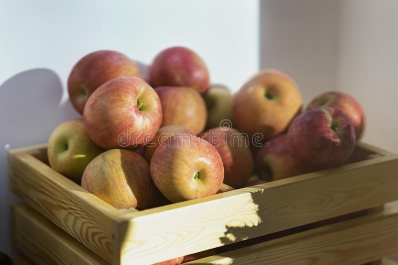 Pile of red apples in a wooden box at the farmers market. royalty free stock photo