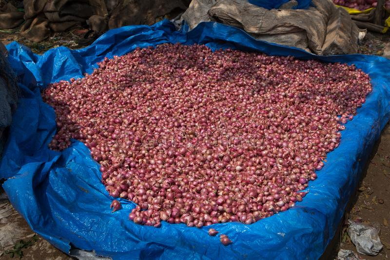 Pile of red onions at a roadside food market India stock photos