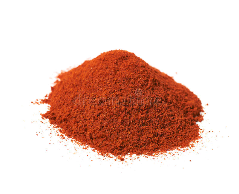 Pile of red paprika powder isolated. Over the white background stock image