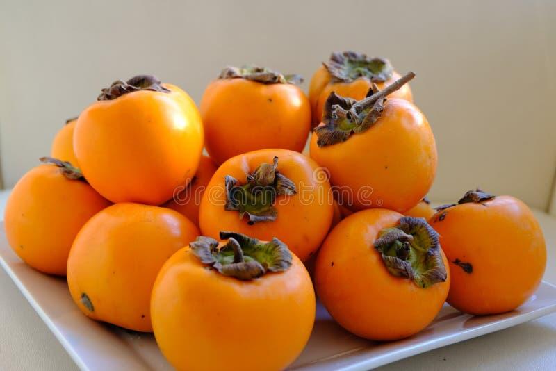 Pile of ripe orange persimmon fruit.  royalty free stock photos