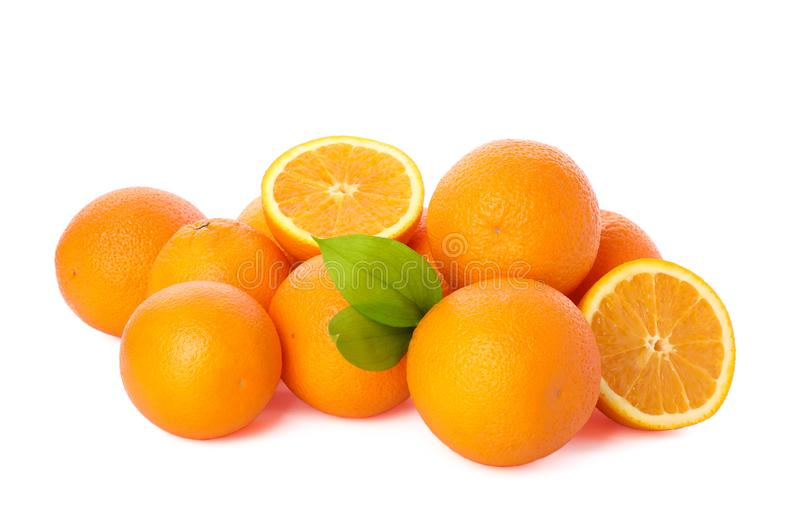 Pile of ripe oranges isolated on white background. Healthy food royalty free stock images