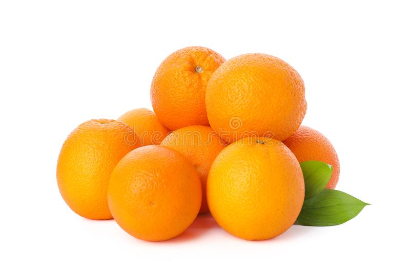 Pile of ripe oranges isolated on white background. Healthy food royalty free stock photography