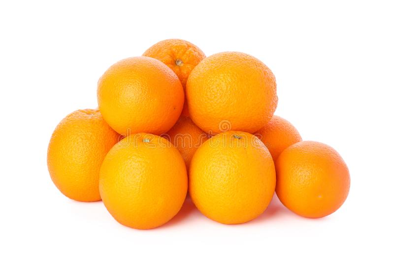 Pile of ripe oranges isolated on white background. Healthy food stock photos