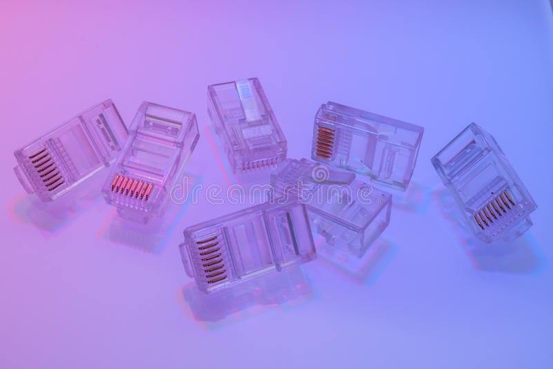 Pile of RJ45 ethernet connectors. Isolated on white background and color light stock images