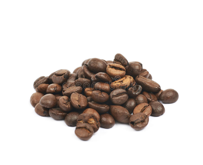 Pile of roasted coffee beans isolated. Pile of brown roasted coffee beans isolated over the white background royalty free stock image