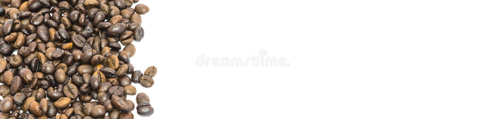 Pile of roasted Vietnamese robusta coffee beans isolated on white. Vertical banner style pile of roasted Vietnamese robusta coffee beans isolated on white stock photo