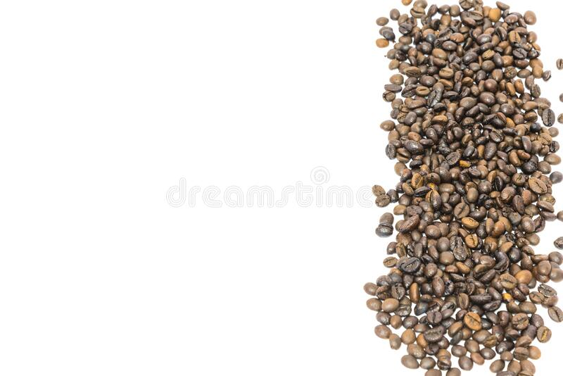 Pile of roasted Vietnamese robusta coffee beans isolated on white. Vertical banner style pile of roasted Vietnamese robusta coffee beans isolated on white royalty free stock photography
