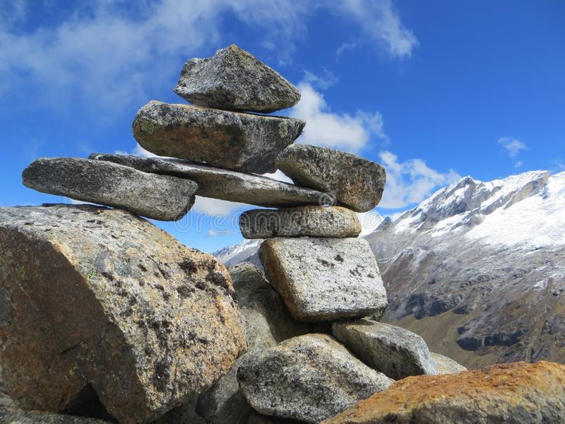 Pile of rocks balancing high up in the mountains, summit, mountain cairn, journey, path, royalty free stock images