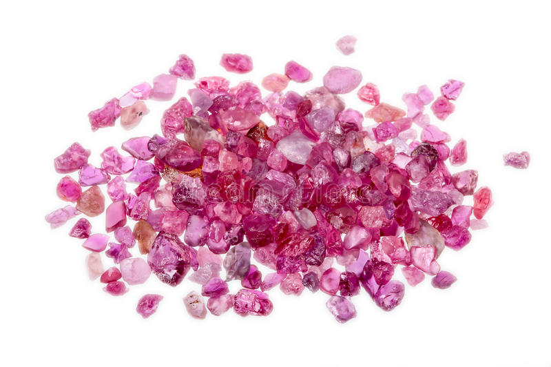 A pile of rough uncut pink red ruby. A pile of natural red and pink rough uncut rubies stock image