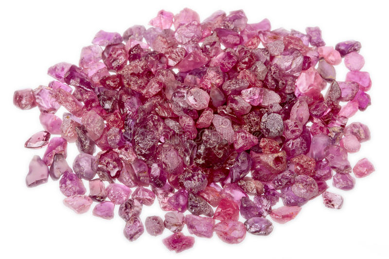 A pile of rough uncut pink red ruby. A pile of natural red and pink rough uncut rubies royalty free stock image