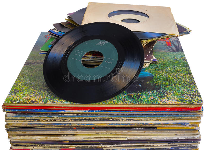 Pile of 45 and 33 RPM vinyl records used royalty free stock image