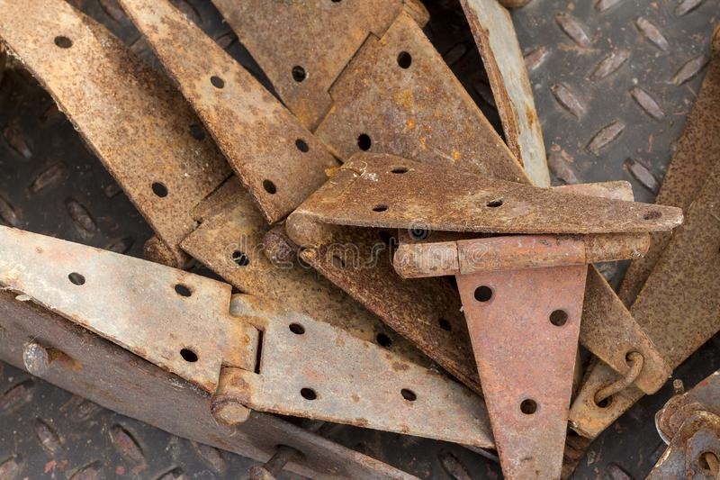 Pile of Rusty Hinges royalty free stock images