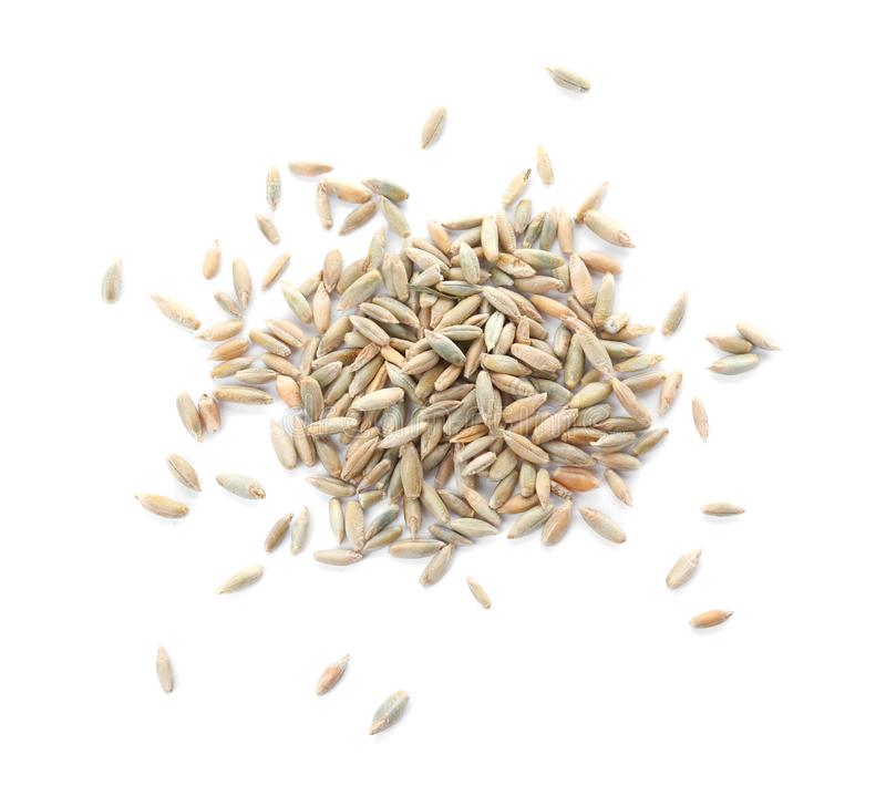 Pile of rye grains on white , top view. Cereal crop stock photo