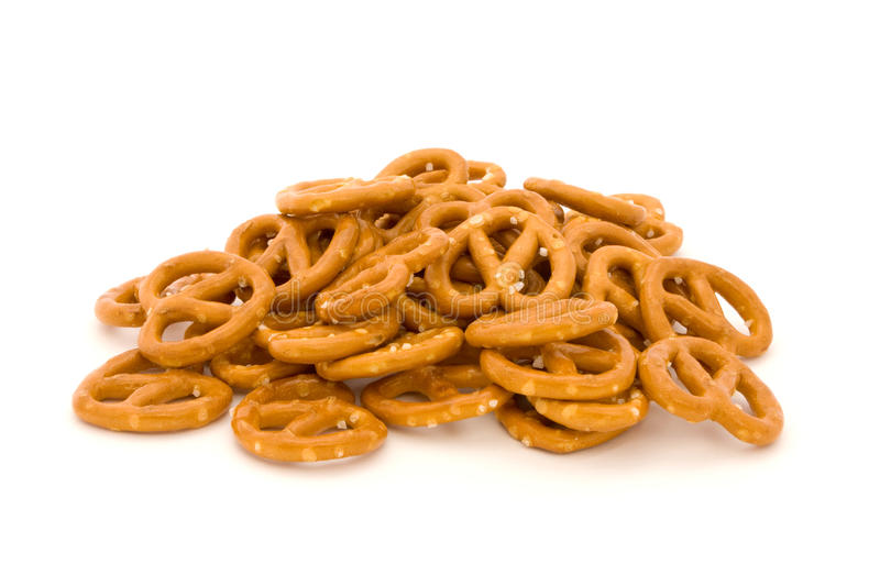 Pile of salted pretzels on white royalty free stock images