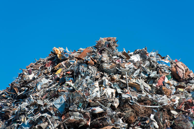 Pile of scrap metal. Over blue sky royalty free stock image