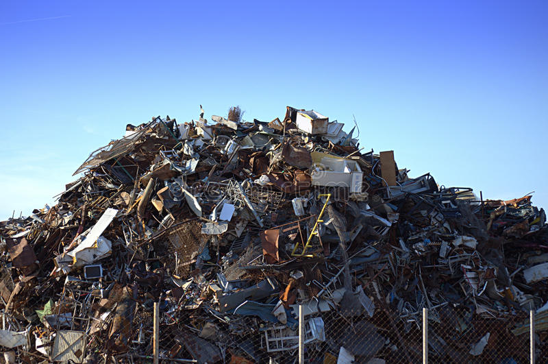 Pile of scrap metal. A view of a large pile of scrap metal at a junkyard or recycling plant royalty free stock image