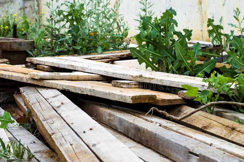 A pile of scrap wood. In a garden royalty free stock image