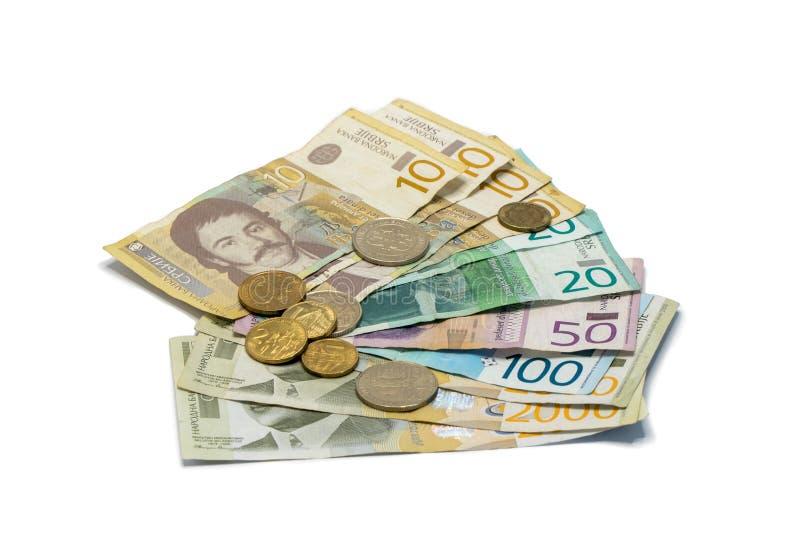Pile serbe d'argent de billets de banque de valeur différente dans les dinars serbes avec différentes pièces de monnaie dans les  images stock