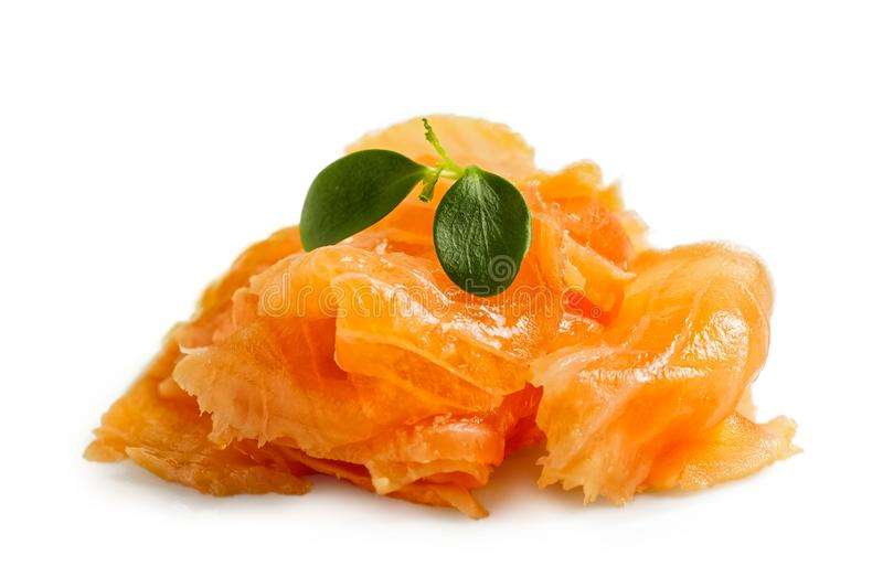 A pile of shaved salmon with garnish isolated on white. Fish royalty free stock photography